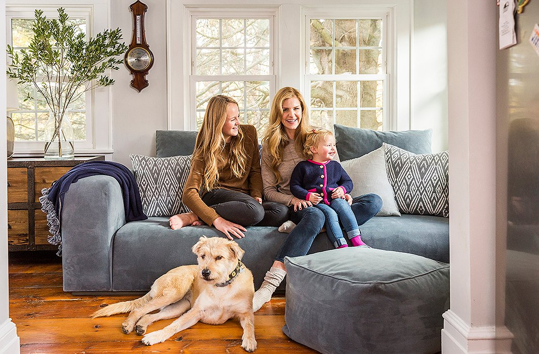 """Alicia, Alana, and Alegra get comfy with Canela, the family rescue dog, in the seating area beside the kitchen. """"I like to sit there mostly because I can see everything that's going on in the house and the kitchen,"""" Aliciasays."""