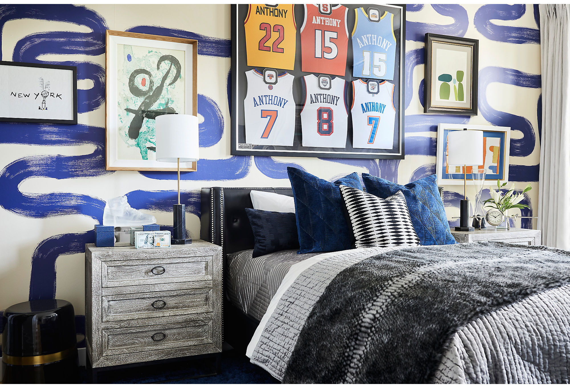 Nikki had a lot of fun with the palette in the room of La La's son. She hung together multiple pieces of art alongside the jerseys of Kiyan's father, Carmello Anthony.