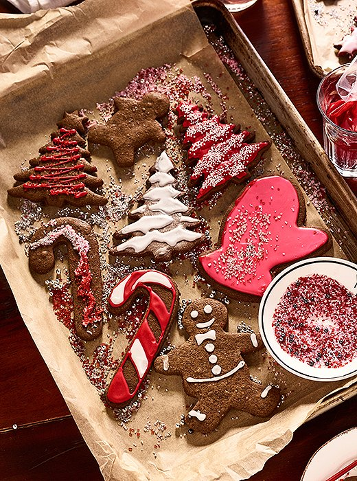 "Red and white icing makes a classic topper for gingerbread cookies—with plenty of sprinkles, of course. The girls were ""all over it."""