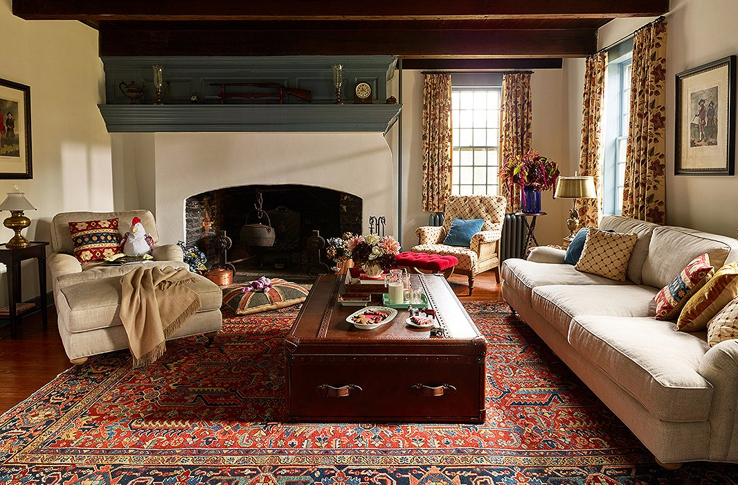The snug living room is made even cozier through layers of textiles and plenty of plush seating. Built in the 17th century, the house is a prime example of historic Dutch architecture—so much so that the local historical society leads tours here several times a year.