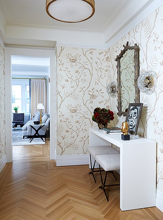 "Graceful wallpaper makes an impact in the entry. ""We wanted something that felt a little bit feminine but clean and simple at the same time,"" says Vivian."