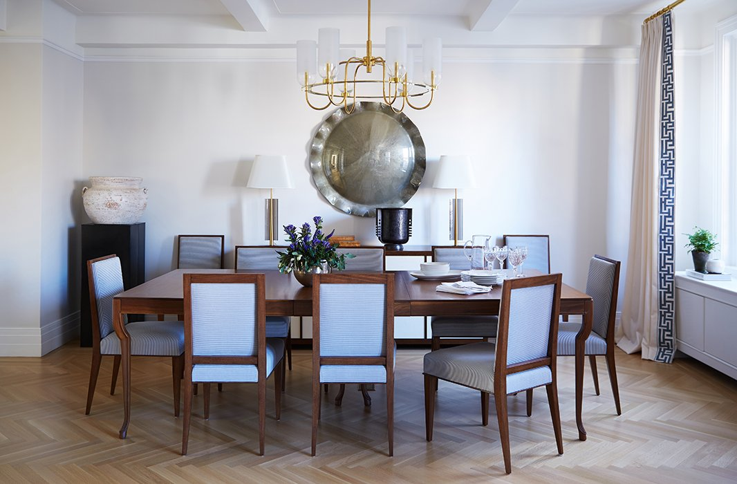 "In the dining room, Alyssa and Vivian chose striking pieces, such as the convex mirror and the vintage table lamps, that could almost double as art. ""We also have this beautiful glass chandelier to add warmth,"" says Vivian."