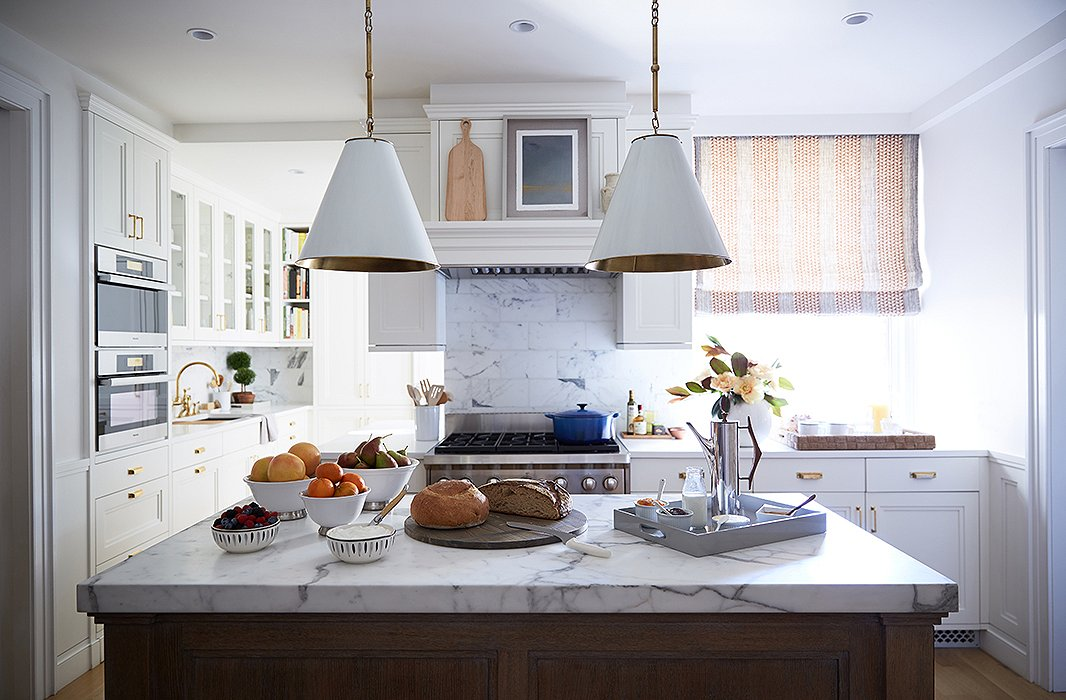 "The kitchen island was a must-have for the wife, who once worked in one of New York's best restaurants. ""Maneuvering things in the kitchen to make sure she was able to get that was fun and interesting,"" says Vivian."