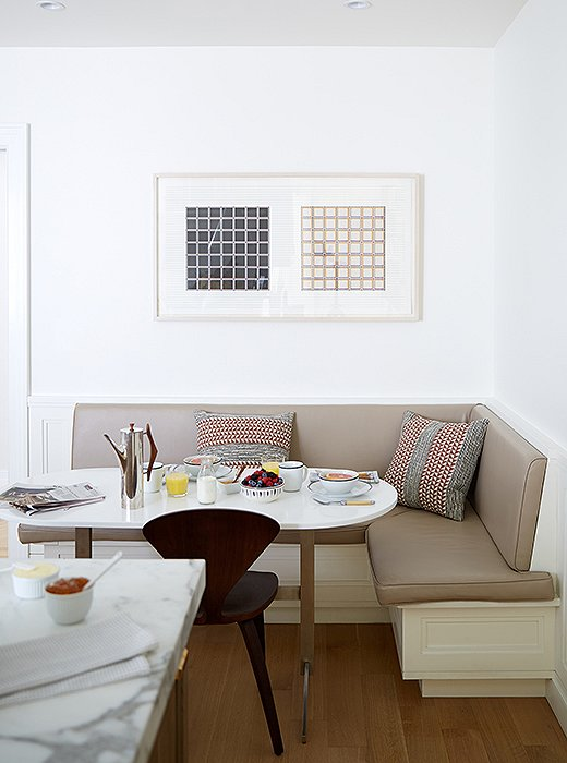 The family's four boys love piling into the breakfast nook for meals and homework. Alyssa and Vivian paired a banquette upholstered in kidproof vinyl with a custom table.