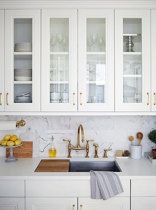 "Rich materials including brass and marble accent the kitchen. ""Brass is such a warm metal,"" says Vivian ""One of the ways we accomplished that warm feeling in the apartment was by using brass."""