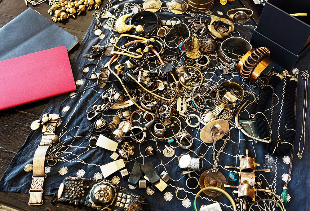 "Piles of bijoux inspire Erin while she works. ""I believe in osmosis: If you surround yourself with things you love, they subconsciously become part of your design process,"" she says. A dive into this jumble can usually cure a creative block."