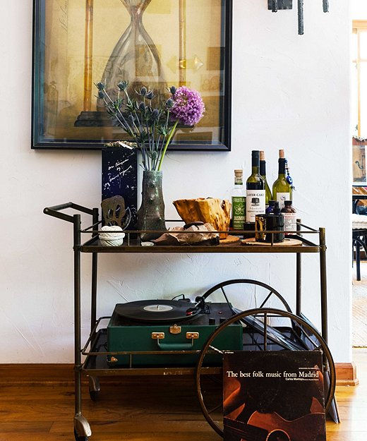 "Erin's living room essential? A bar cart. ""They come in every shape and can go superluxe or old-school Hollywood."" This one houses her coveted record player—so music and drink are at the ready when friends turn up."