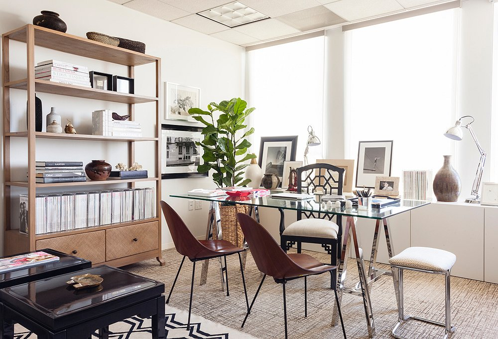 The office is square, roughly 14' by 15', but an asymmetrical furniture floor plan keeps it from feeling boxy.