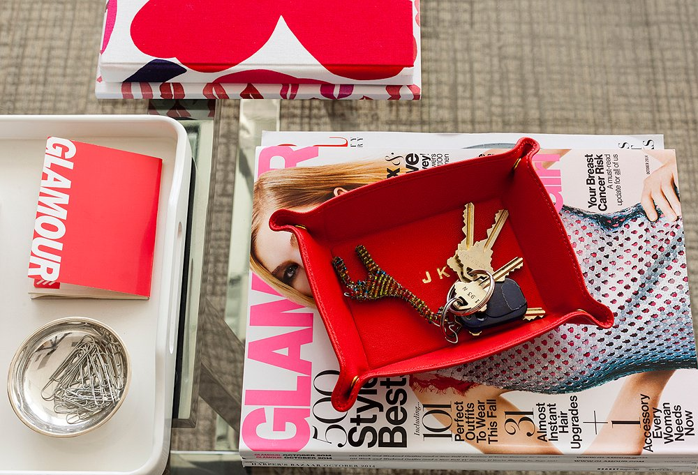 The staples: keys on a beaded giraffe keychain and the current issue of Glamour. Trays are crucial catchalls on any desk.