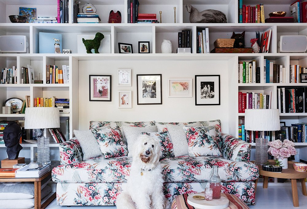 863077d5d9bf5 Irene smartly alternates a few gray pillows into the patterned sofa and  tucks larger pillows under