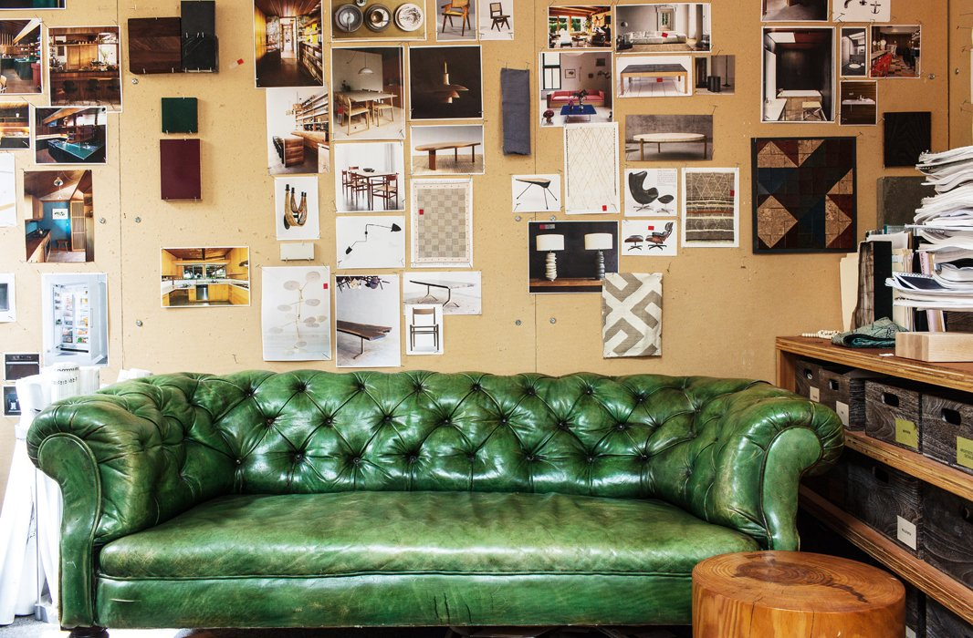 """A couch to sit on once in a while is something I've always loved having in an office,"" Pam says of the little green chesterfield she's ""had forever."""