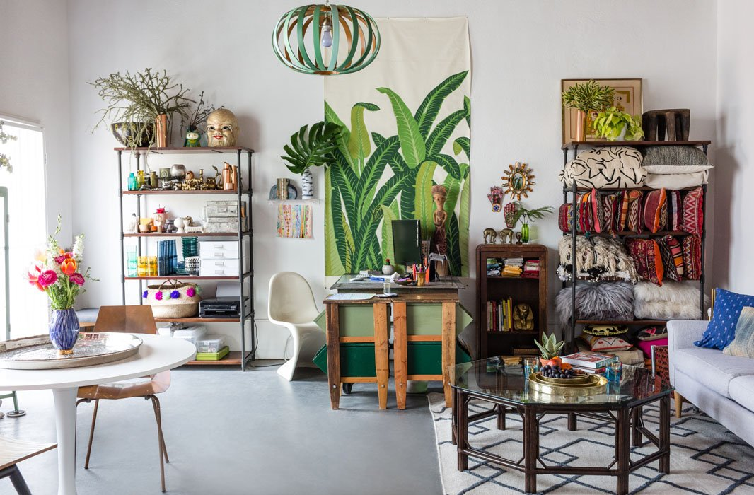 Justina's open, light-filled studio brims with colorful inspirations, from the Panton chair, which had been her grandma's, to the vintage vinyl palm print to the bookcase filled with kilims, Berber pillows, and other textiles.