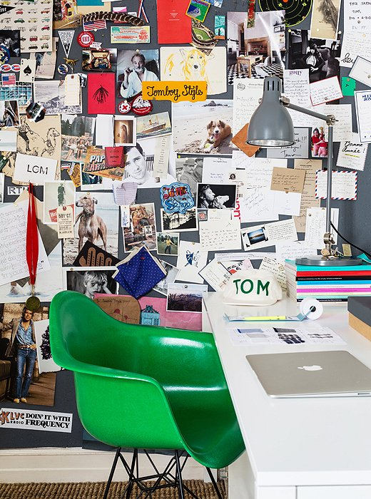 Lizzie's work space features a green Eames replica from Modernica and a killer inspiration board.