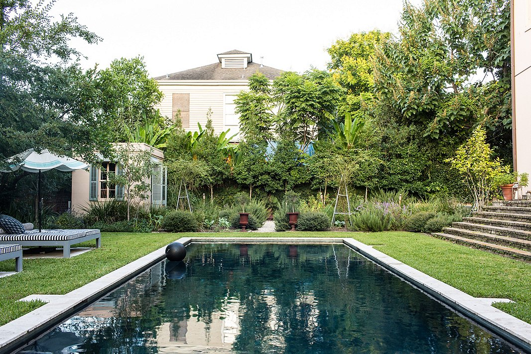 A darkened bottom gives this pool, set amid historic architecture, a statement-making, dramatic look. Photo by Nicole LaMotte.