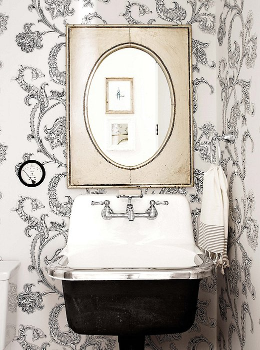 Imagine this bathroom with a standard white pedestal sink. The wallpaper would not have the same effect if the pop of extra black were not on the base of the sink.