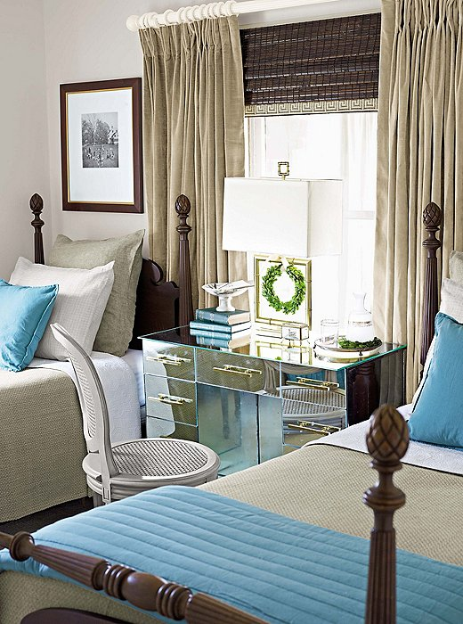 How many times have you seen a version of these twin beds? They are a staple of so many guest rooms, but look how easily you can give your guests something to write home about by adding a blingy mirrored desk (that doubles as a nightstand) and some generous pops of color.