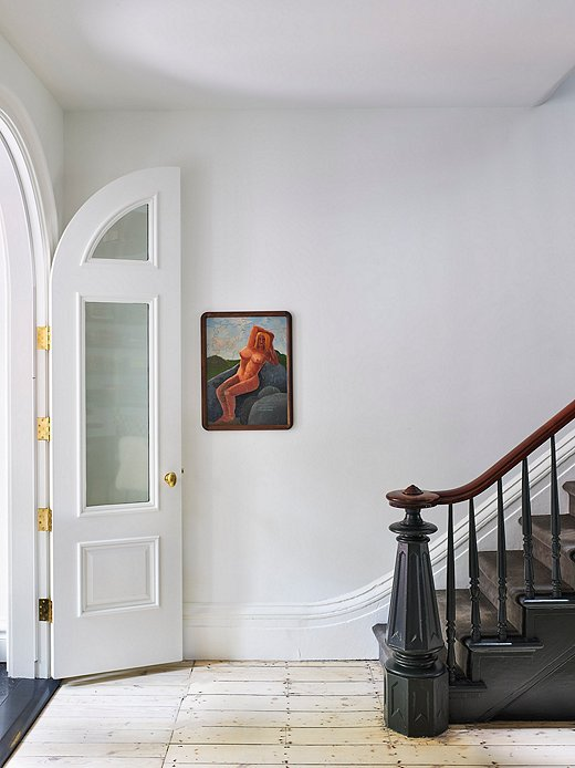 "Restoring and keeping the original staircase was important to Olivia. It is a perfect example of the ethos behind her restoration process. ""Everything was chosen for the material being available and contextual to the time when the house was built,"" she says."