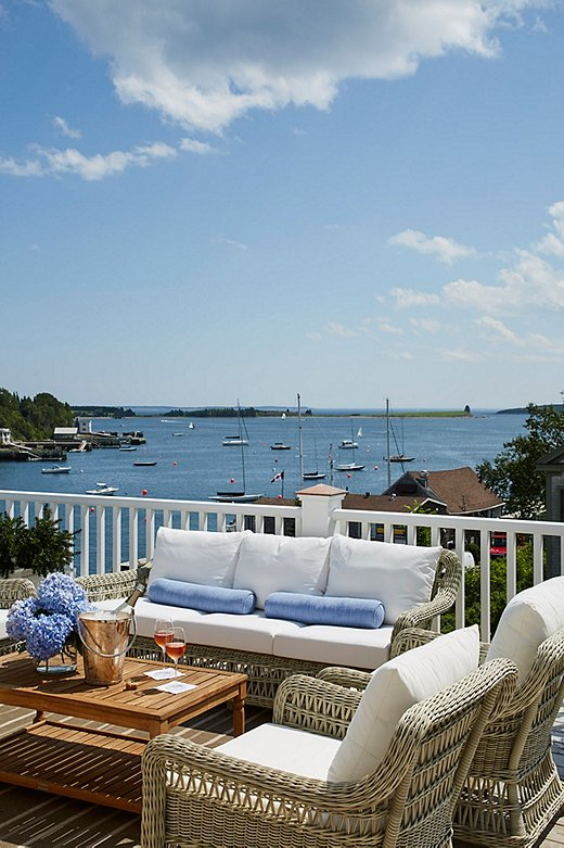 The third-floor deck, overlooking the harbor, is a favorite spot for entertaining—understandably so. The coffee table was a One Kings Lane purchase.