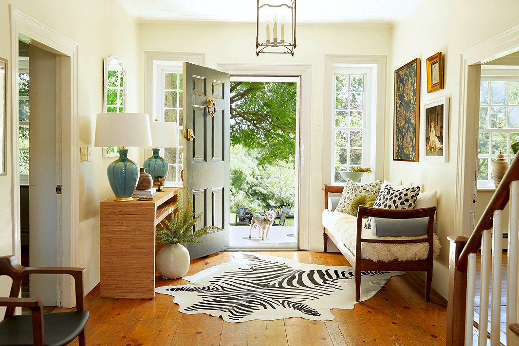 A zebra-print hide rug, hand-thrown table lamps, a Dawn Wolfe chinoiserie print next to a Slim Aarons photograph, a sleek bench topped with a toasty sheepskin and a bevy of pillows (including the dotted Dahlia in two colorways): What do they have in common?Stellar craftsmanship, classic themes, and an emphasis on quality materials that allow them to work beautifully together.