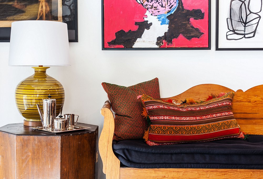 A vignette captures the designers' old-meets-new ethos. Vintage artwork,