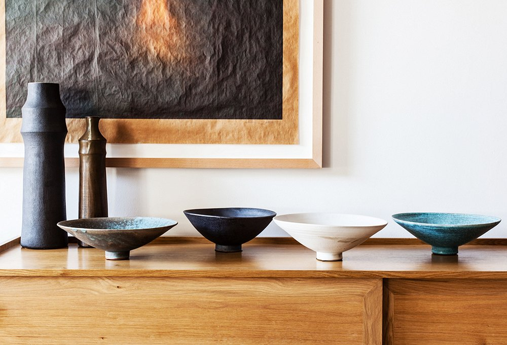 """We love these colors and fluid shapes,"" says Amy, who along with Todd is a champion of designs by L.A. artisans, such as these vases by Marina Kim and bowls by Dino Sophia."