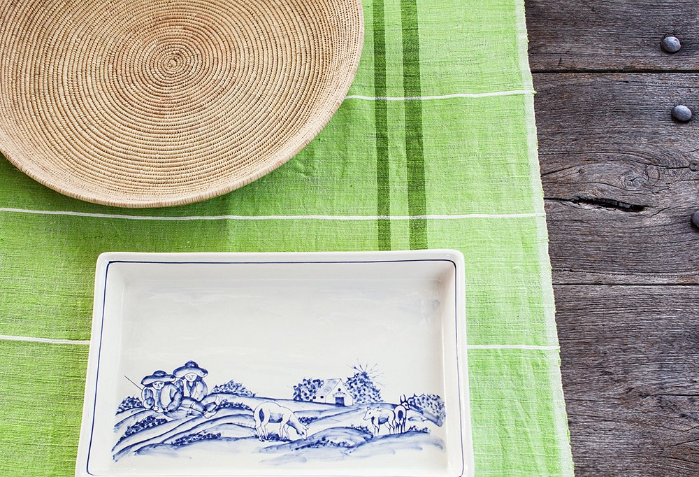 Among pieces new to the shop are blue-and-white Portuguese plates and platters hand-painted with bucolic scenes.