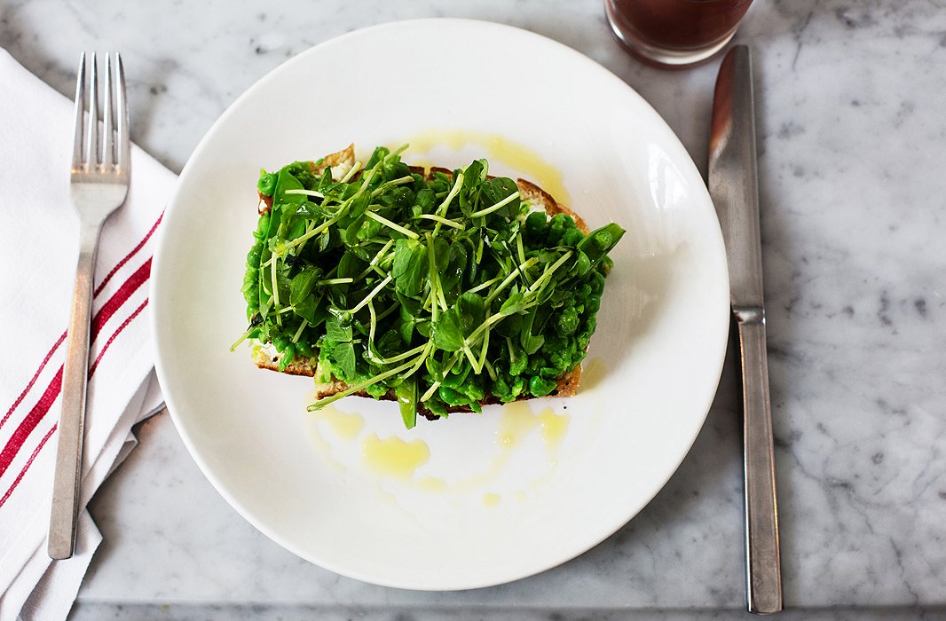 The pea toast at Salt Air, made with ricotta, caramelized onions, jalepeño, sugar snap peas, and pea shoots.