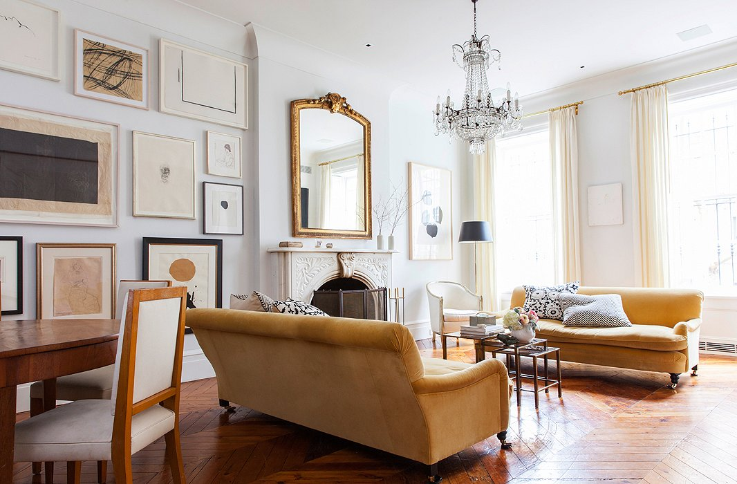 The living area is set off by a pair of velvet George Smith sofas and a chandelier found at Clignancourt, the famed Paris flea market. Alison skipped a rug in favor of showing off the beautiful wood floors.