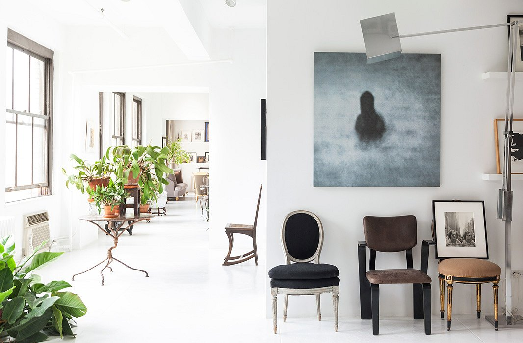 A large-scale photograph by Israeli artist Michal Rovner has remained a focal point and fixture in the apartment, as has the 1960s Italian floor lamp.