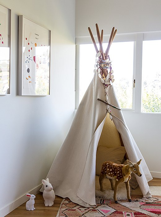 "A tepee from House Inhabit commands one corner of James's room, filled with ""a collection of pillows, a sheepskin, and a revolving door of animals, dolls, and often our dog, Blue,"" Jessica says."
