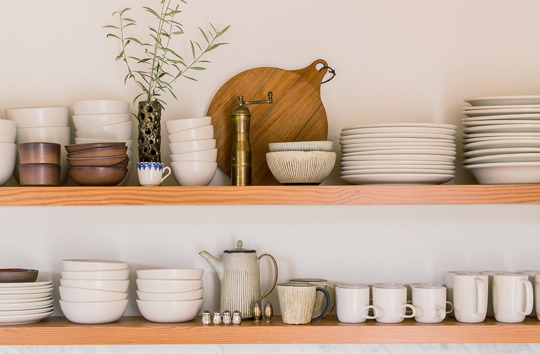 "An admitted ceramics-lover, Jessica uses the kitchen's open shelving to display an alluring array. ""Most are from Heath and Akio, but it's good to mix up tones and textures,"" she says. ""There's some vintage there too."" Her other kitchen essentials? ""A Vitamix, a cast-iron pot, and Moon Juice overnight oats."""