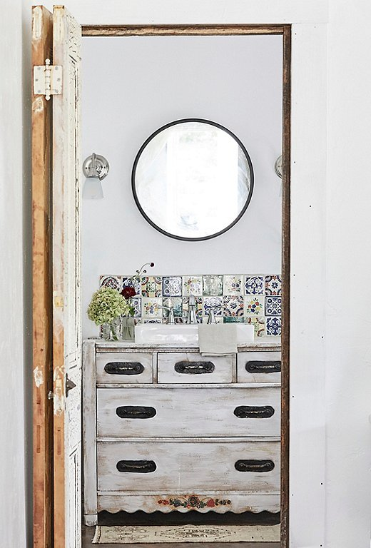 Vintage Spanish-inspired tiles add a hint of color to the bathroom of #405 Whispering Trails.