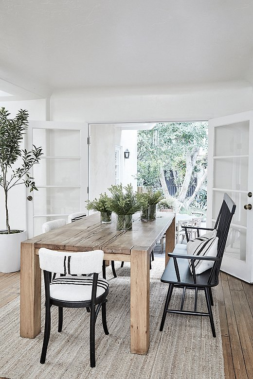 """Tammy relied on natural materials to ease the flow between the indoor and outdoor spaces. In the dining room, she used vintage Berber tribal kilim textiles to add a layer of softness. """"Those doors open right to the outdoor space and they're open most of the time, so I feel like it needed to live together,"""" says Tammy."""