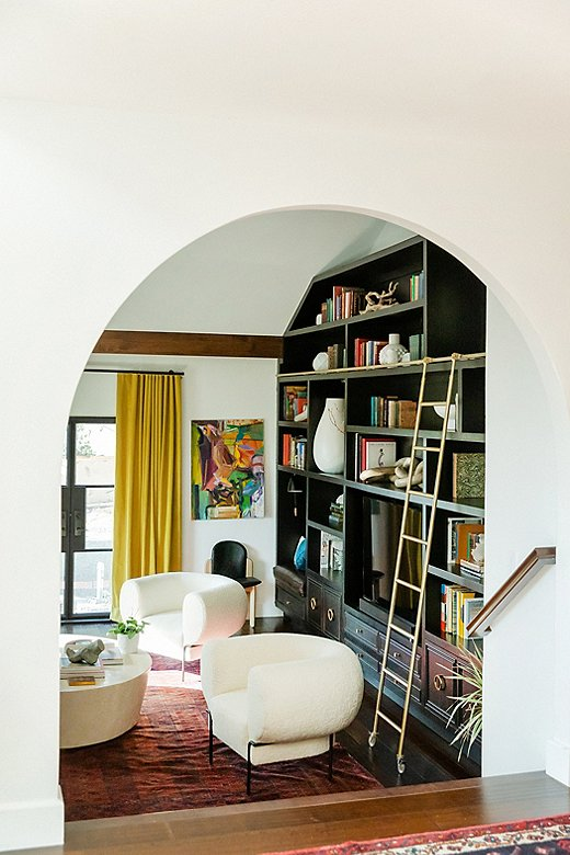 Arched elements throughout the house give it an architectural moral compass, according to Jessie. The formal living room saw the most dramatic change with the introduction of an arched doorway and the built-in bookcase.
