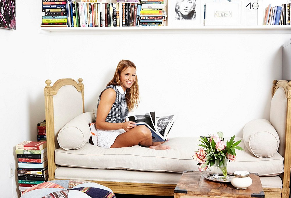 Style-setting designer Charlotte Ronson on her day bed in her happy place: surrounded by books.