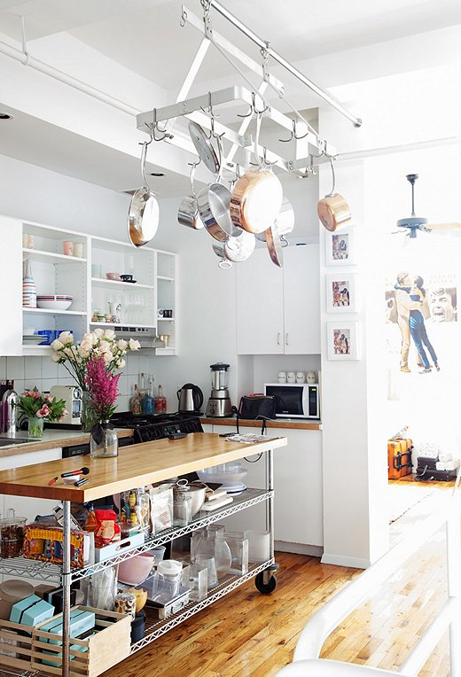 Since space is at a premium in NYC apartments, Ronson hoisted up her mixed-metal pots and pans with a handy hanging rack to free up precious cabinet space.