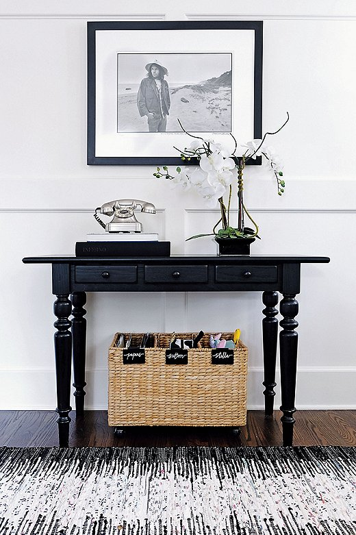 An entry table with three drawers and a labeled basket tucked below make this petite foyer both fabulous and functional.