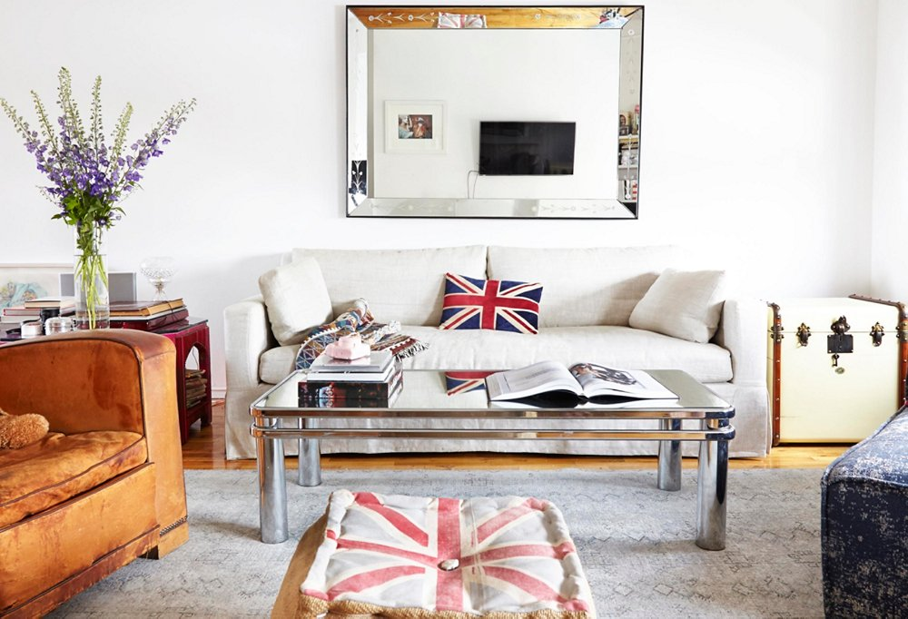 A denim chaise and some faded British flags ground Ronson's living room in blues and reds.