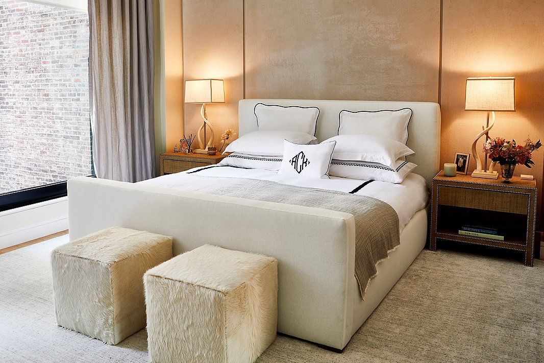 """Manhattan apartments aren't known for being spacious, but """"having the ability to come together as a family for dinner or movie night in the living and dining areas but then be able to retreat to our own rooms makes the space feel much bigger,"""" Ashley says. Find the main bedroom's linen-upholstered bed here."""