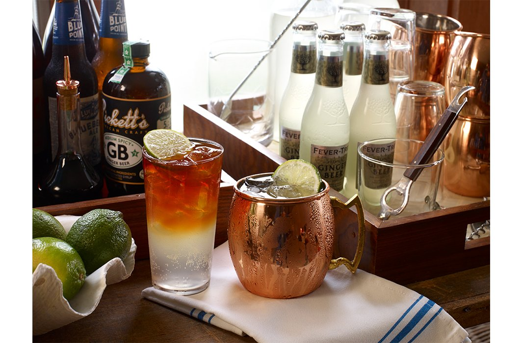 A Dark 'n' Stormy (left, Matt's favorite) and a Moscow mule make festive predinner libations—and require many of the same key ingredients.
