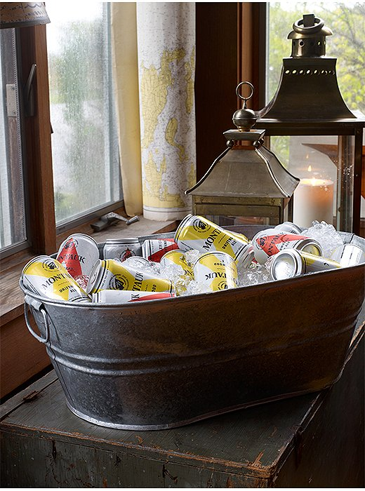 Easier than a cocktail but just as pretty, a tub full of ice and Montauk Ale brings the beachy vibe inside. Put one out and let guests help themselves.