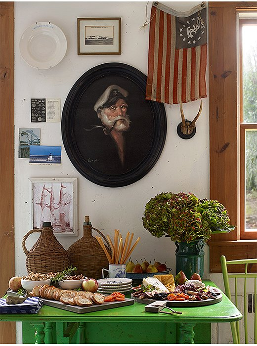 In the kitchen, distract guests who linger with an artful array of cheeses, crackers, and other small bites.