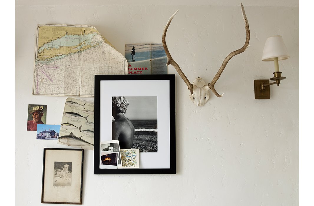 Tacked to perfection: A photograph by Matt is surrounded by a loose arrangement of unframed images and memorabilia.