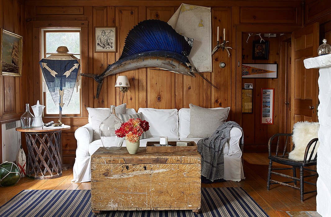 "The living room's preppy mix is anchored by a vintage dhurrie rug (find a similar one here) and a secondhand sailfish. ""Good vintage is getting harder and harder to find,"" says Matt. ""The craft and care that old things were made with is an important thing to have in a home, I think. They just make it feel special."""