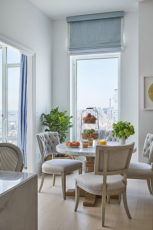 The kitchen features a lovely breakfast nook and seating for four. The tufted side chairs and chic table offer a more casual alternative to the formal dining room.
