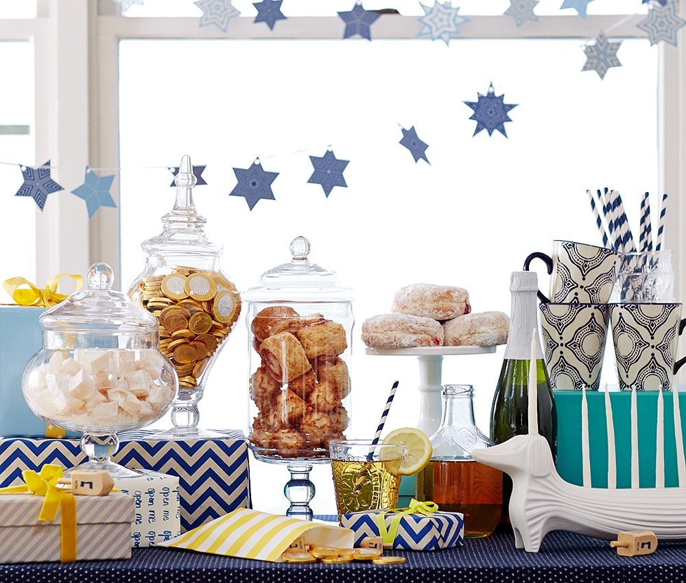 Fill canisters and plates with rugelach, powdered doughnuts, cookies, and of course, lots of gelt.