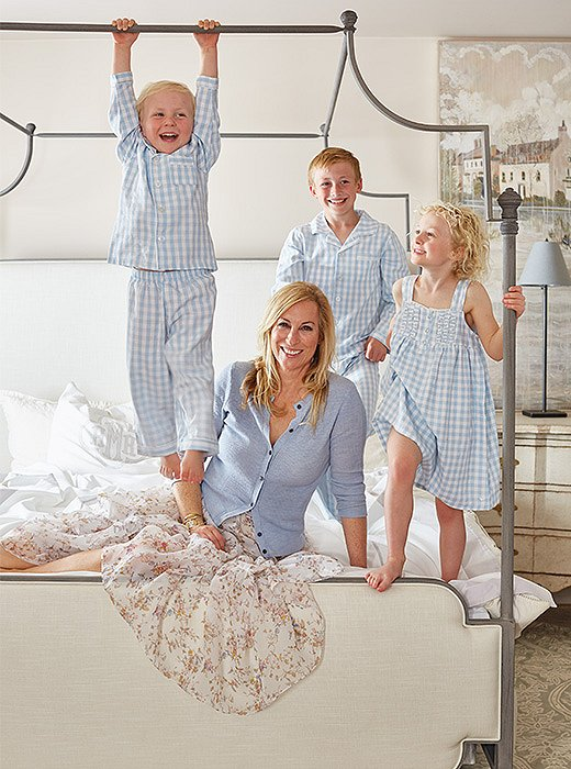 Alice Ryan Miller and her three children monkey around on the Loren Canopy Bed. Photo by Victoria Pearson.