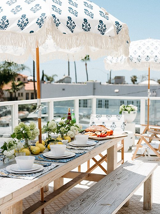 Cydney used the Luna Holiday Beach Umbrella, a One Kings Lane exclusive, as inspiration for the tablescape.