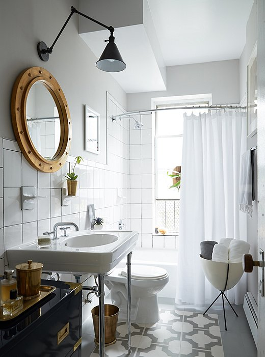 Make an old bathroom feel like new again with a white shower curtain and fresh grout. (Click here for a step-by-step how-to).