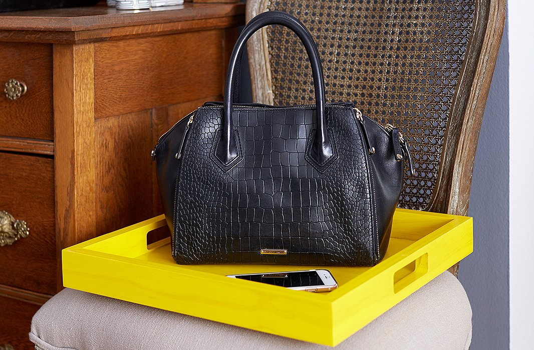 Just off the entry hall, a bright lacquered tray functions as a catchall and bag drop.